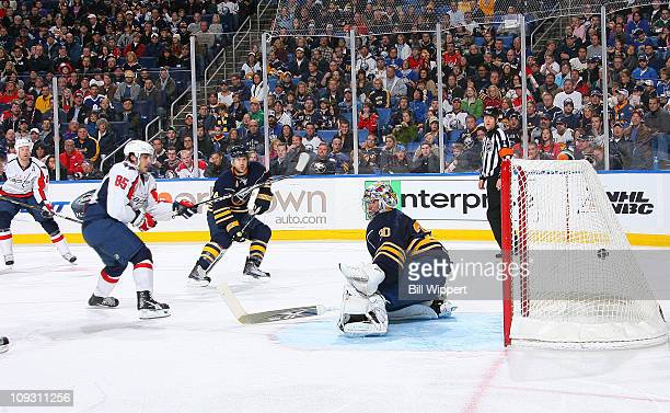 Mathieu Perreault of the Washington Capitals scores a second period goal against Ryan Miller of the Buffalo Sabres at HSBC Arena on February 20 2011...