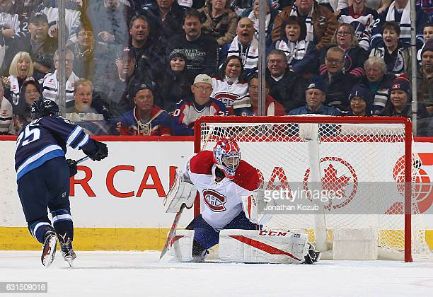 Mathieu Perreault of the Winnipeg Jets bulges the twine behind goaltender Al Montoya of the Montreal Canadiens for a first period goal at the MTS...