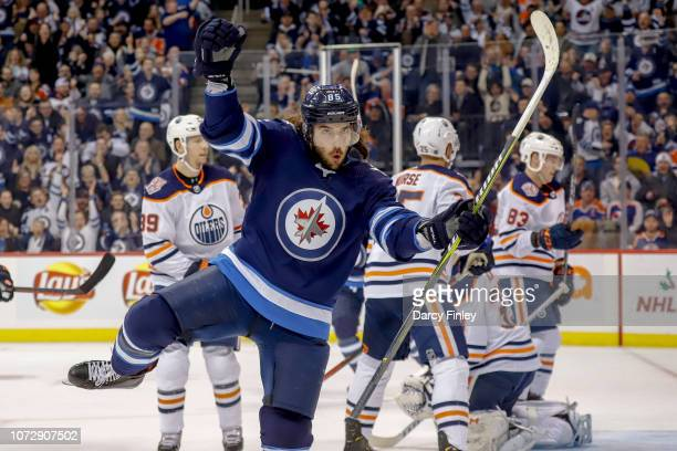 Mathieu Perreault of the Winnipeg Jets celebrates a first period goal against the Edmonton Oilers at the Bell MTS Place on December 13 2018 in...