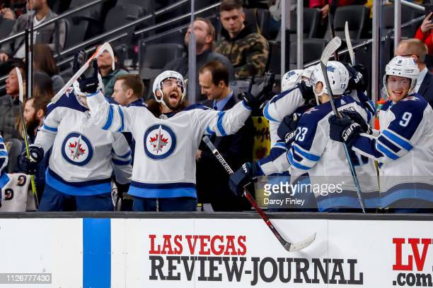 Mathieu Perreault of the Winnipeg Jets celebrates a second period goal by Patrik Laine against the Vegas Golden Knights with teammates at the bench...