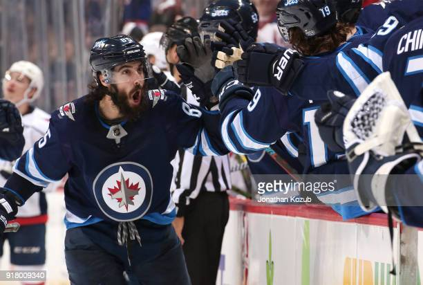 Mathieu Perreault of the Winnipeg Jets celebrates a third period goal scored by teammate Mark Scheifele against the Washington Capitals with...