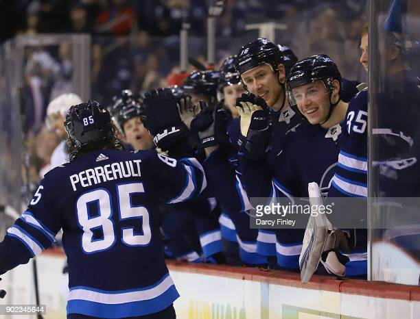 Mathieu Perreault of the Winnipeg Jets celebrates his second period goal against the San Jose Sharks with teammates at the bench at the Bell MTS...