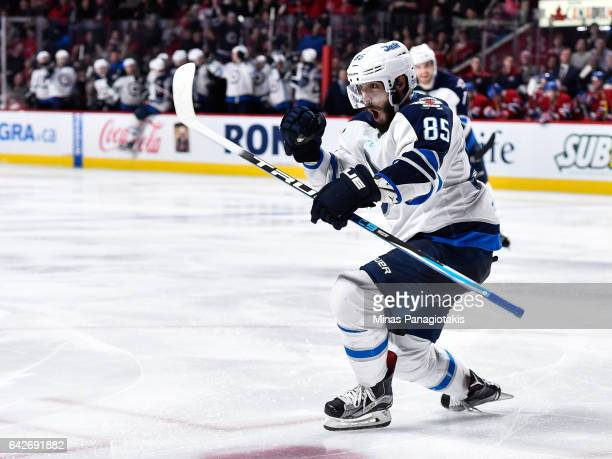 Mathieu Perreault of the Winnipeg Jets celebrates his third period goal during the NHL game against the Montreal Canadiens at the Bell Centre on...