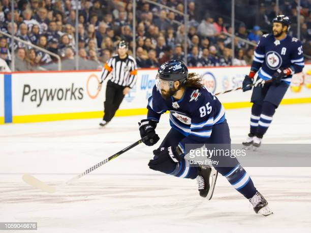Mathieu Perreault of the Winnipeg Jets follows the play down the ice during second period action against the St Louis Blues at the Bell MTS Place on...