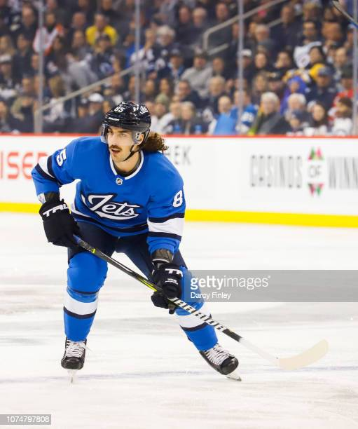 Mathieu Perreault of the Winnipeg Jets follows the play down the ice during first period action against the Pittsburgh Penguins at the Bell MTS Place...