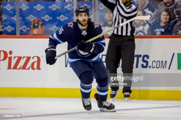 Mathieu Perreault of the Winnipeg Jets follows the play down the ice during third period action against the Anaheim Ducks at the Bell MTS Place on...