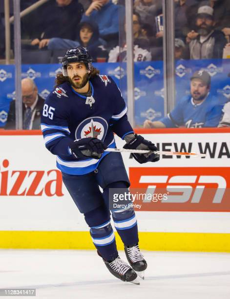 Mathieu Perreault of the Winnipeg Jets follows the play down the ice during first period action against the San Jose Sharks at the Bell MTS Place on...