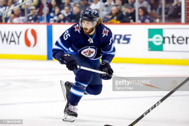 Mathieu Perreault of the Winnipeg Jets follows the play down the ice during first period action against the Boston Bruins at the Bell MTS Place on...