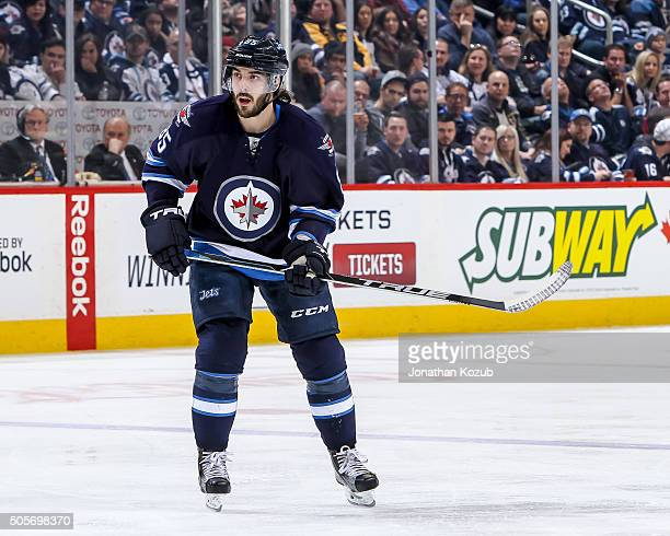 Mathieu Perreault of the Winnipeg Jets follows the play down the ice during second period action against the San Jose Sharks at the MTS Centre on...