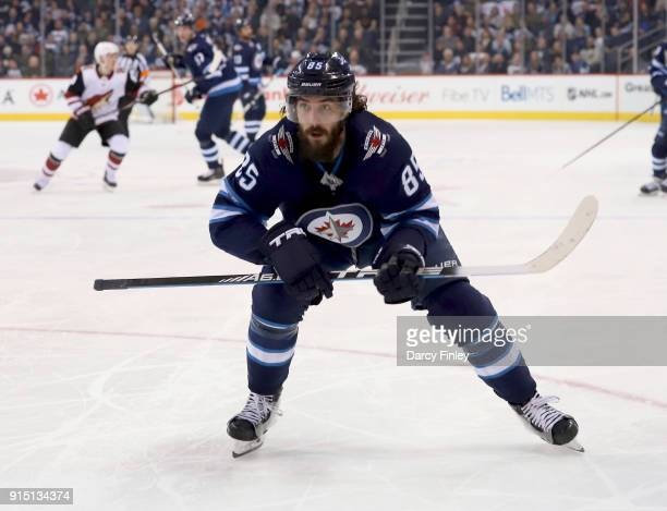 Mathieu Perreault of the Winnipeg Jets follows the play down the ice during second period action against the Arizona Coyotes at the Bell MTS Place on...