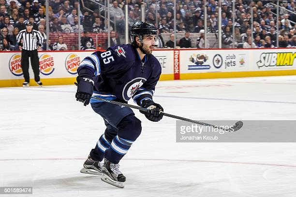 Mathieu Perreault of the Winnipeg Jets follows the play up the ice during second period action against the Columbus Blue Jackets at the MTS Centre on...