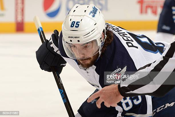 Mathieu Perreault of the Winnipeg Jets gets ready to take a faceoff against the Arizona Coyotes at Gila River Arena on December 31 2015 in Glendale...