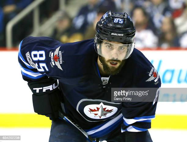 Mathieu Perreault of the Winnipeg Jets gets set for a third period faceoff against the Minnesota Wild at the MTS Centre on February 7 2017 in...
