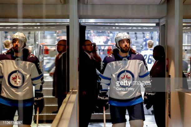 Mathieu Perreault of the Winnipeg Jets heads off the ice following the pregame warm up prior to NHL action against the Vegas Golden Knights at...