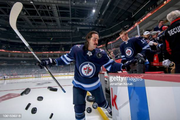 Mathieu Perreault of the Winnipeg Jets hits the ice for the start of the pregame warm up prior to NHL action against the Washington Capitals at the...