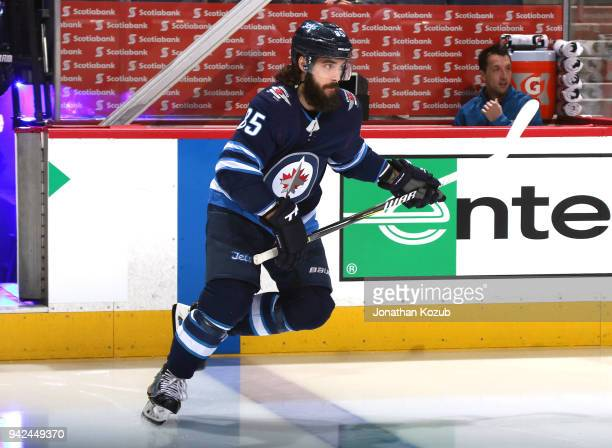 Mathieu Perreault of the Winnipeg Jets hits the ice prior to puck drop against the Calgary Flames at the Bell MTS Place on April 5 2018 in Winnipeg...
