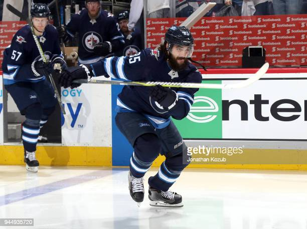 Mathieu Perreault of the Winnipeg Jets hits the ice prior to puck drop against the Minnesota Wild in Game One of the Western Conference First Round...