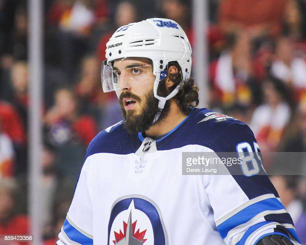 Mathieu Perreault of the Winnipeg Jets in action against the Calgary Flames during an NHL game at Scotiabank Saddledome on October 7 2017 in Calgary...