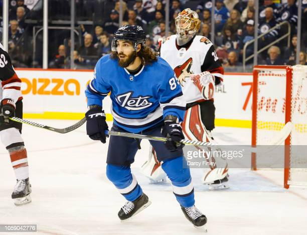 Mathieu Perreault of the Winnipeg Jets keeps an eye on the play during first period action against the Arizona Coyotes at the Bell MTS Place on...
