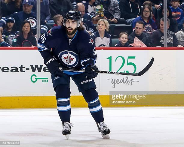 Mathieu Perreault of the Winnipeg Jets keeps an eye on the play during first period action against the Anaheim Ducks at the MTS Centre on March 20...