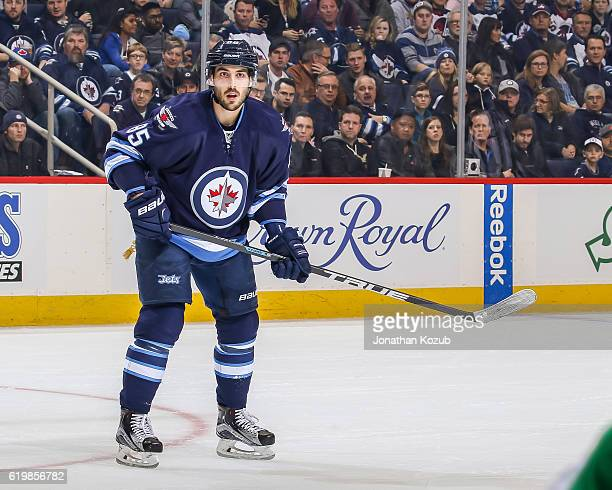 Mathieu Perreault of the Winnipeg Jets keeps an eye on the play during first period action against the Dallas Stars at the MTS Centre on October 27...