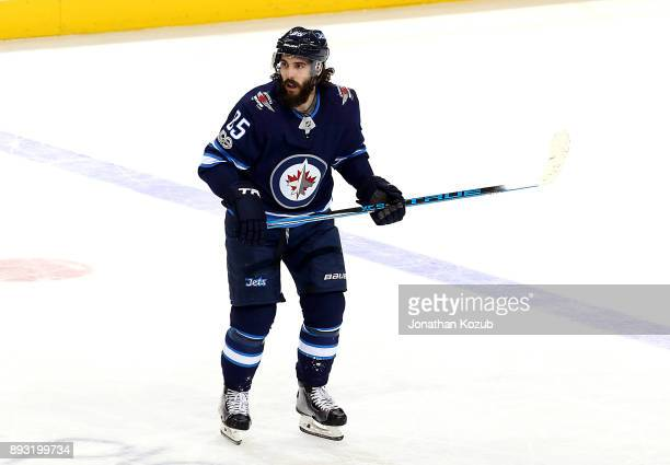 Mathieu Perreault of the Winnipeg Jets keeps an eye on the play during second period action against the Chicago Blackhawks at the Bell MTS Place on...