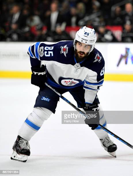 Mathieu Perreault of the Winnipeg Jets lines up for a faceoff against the Los Angeles Kings at Staples Center on November 22 2017 in Los Angeles...
