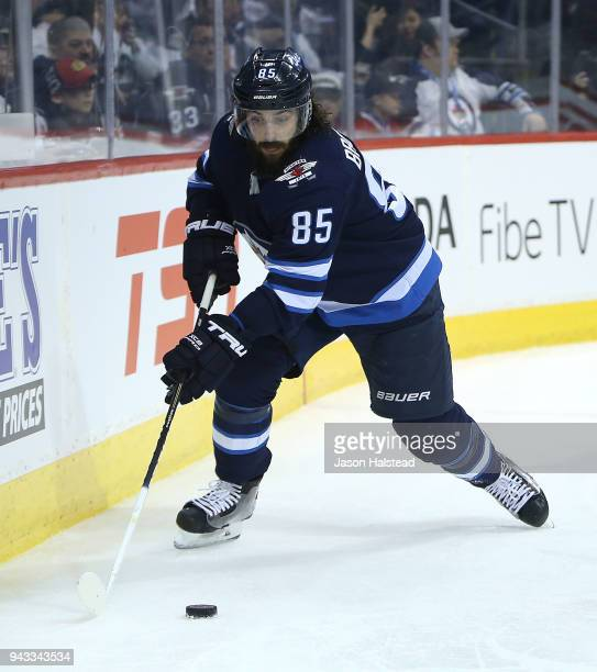 Mathieu Perreault of the Winnipeg Jets moves the puck during NHL action against the Chicago Blackhawks on April 7 2018 at Bell MTS Place in Winnipeg...