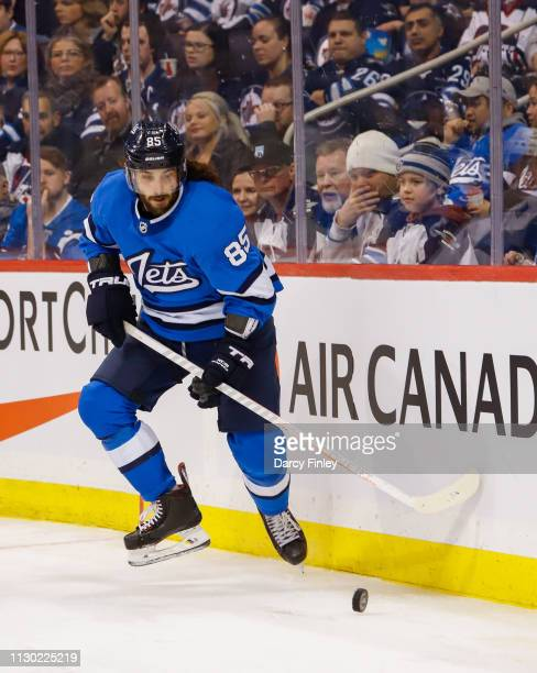 Mathieu Perreault of the Winnipeg Jets plays the puck along the boards during third period action against the Colorado Avalanche at the Bell MTS...