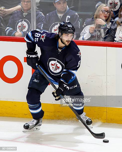 Mathieu Perreault of the Winnipeg Jets plays the puck along the boards during third period action against the Winnipeg Jets at the MTS Centre on...
