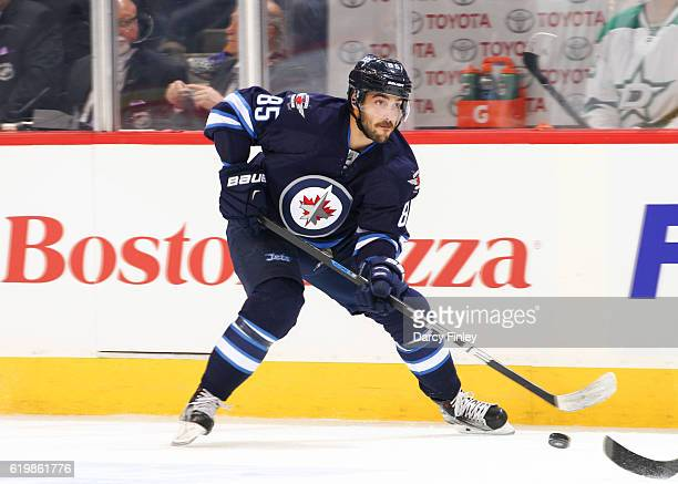 Mathieu Perreault of the Winnipeg Jets plays the puck down the ice during first period action against the Dallas Stars at the MTS Centre on October...