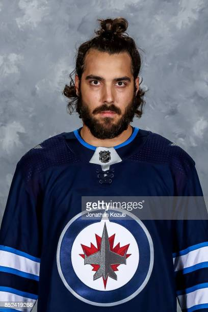 Mathieu Perreault of the Winnipeg Jets poses for his official headshot for the 20172018 season on September 14 2017 at the Bell MTS Iceplex in...