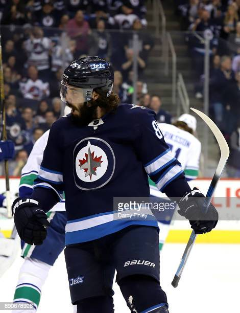 Mathieu Perreault of the Winnipeg Jets reacts after scoring a second period goal against the Vancouver Canucks at the Bell MTS Place on December 11...