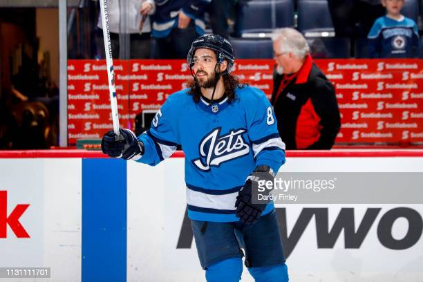 Mathieu Perreault of the Winnipeg Jets salutes the fans after receiving first star honours following a 21 victory over the Calgary Flames at the Bell...