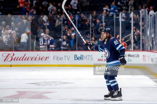 Mathieu Perreault of the Winnipeg Jets salutes the fans after receiving third star honours following a 54 overtime victory over the Edmonton Oilers...