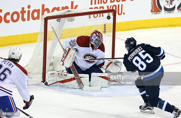 Mathieu Perreault of the Winnipeg Jets scores past Al Montoya of the Montreal Canadiens during NHL action on January 11 2017 at the MTS Centre in...