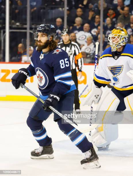 Mathieu Perreault of the Winnipeg Jets screens goaltender Jake Allen of the St Louis Blues during first period action at the Bell MTS Place on...