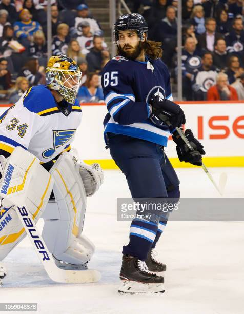 Mathieu Perreault of the Winnipeg Jets screens goaltender Jake Allen of the St Louis Blues during second period action at the Bell MTS Place on...