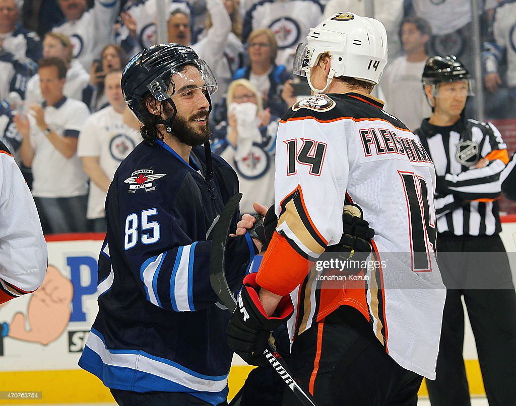 Mathieu Perreault #85 of the Winnipeg Jets shakes hands with Tomas Fleischmann #14 of the Anaheim Ducks after a 5-2 victory by the Ducks in Game Four of the Western Conference Quarterfinals during the 2015 NHL Stanley Cup Playoffs on April 22, 2015 at the MTS Centre in Winnipeg, Manitoba, Canada. The Ducks swept the series 4-0.