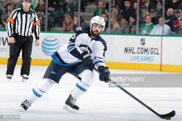 Mathieu Perreault of the Winnipeg Jets skates against the Dallas Stars at the American Airlines Center on January 15 2015 in Dallas Texas