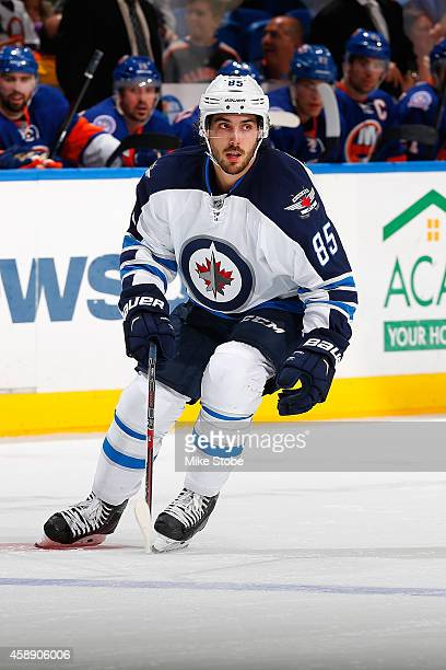 Mathieu Perreault of the Winnipeg Jets skates against the New York Islanders at Nassau Veterans Memorial Coliseum on October 28, 2014 in Uniondale,...