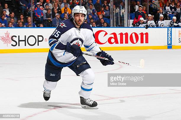 Mathieu Perreault of the Winnipeg Jets skates against the New York Islanders at Nassau Veterans Memorial Coliseum on October 28 2014 in Uniondale New...