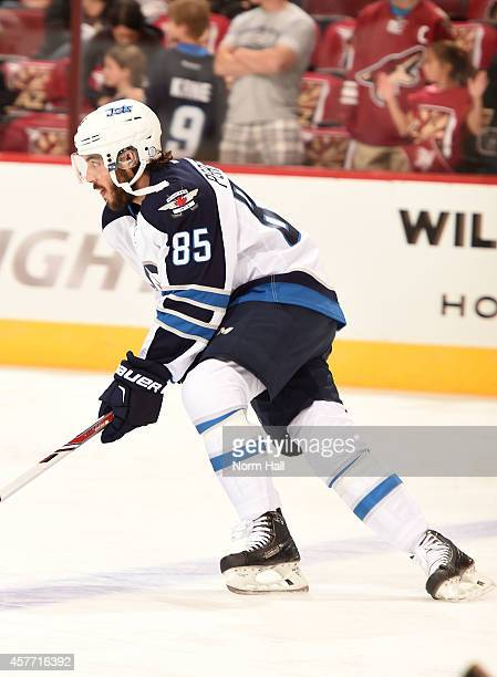 Mathieu Perreault of the Winnipeg Jets skates during warmups prior to a game against the Arizona Coyotes at Gila River Arena on October 9 2014 in...