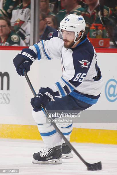 Mathieu Perreault of the Winnipeg Jets skates with the puck against the Minnesota Wild during the game on December 27 2014 at the Xcel Energy Center...