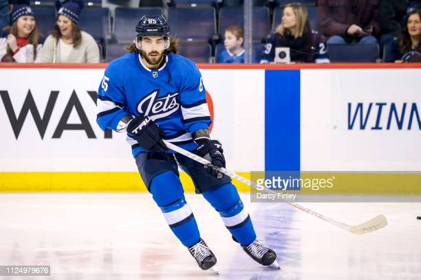 Mathieu Perreault of the Winnipeg Jets takes part in the pregame warm up prior to NHL action against the Colorado Avalanche at the Bell MTS Place on...