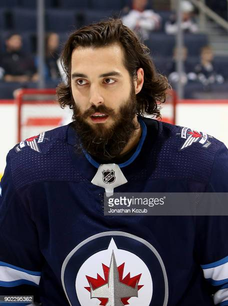 Mathieu Perreault of the Winnipeg Jets takes part in the pregame warm up prior to NHL action against the San Jose Sharks at the Bell MTS Place on...