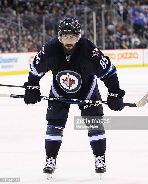 Mathieu Perreault of the Winnipeg Jets waits for the puck to drop for a faceoff in second period action in an NHL game against the Chicago Blackhawks...