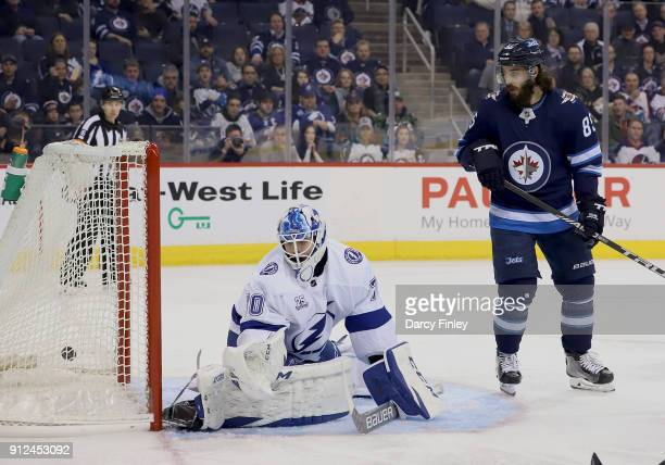 Mathieu Perreault of the Winnipeg Jets watches as the puck gets behind goaltender Louis Domingue of the Tampa Bay Lightning for a third period goal...