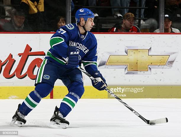 Mathieu Schneider of the Vancouver Canucks skates up ice with the puck during their game against the Detroit Red Wings at General Motors Place on...