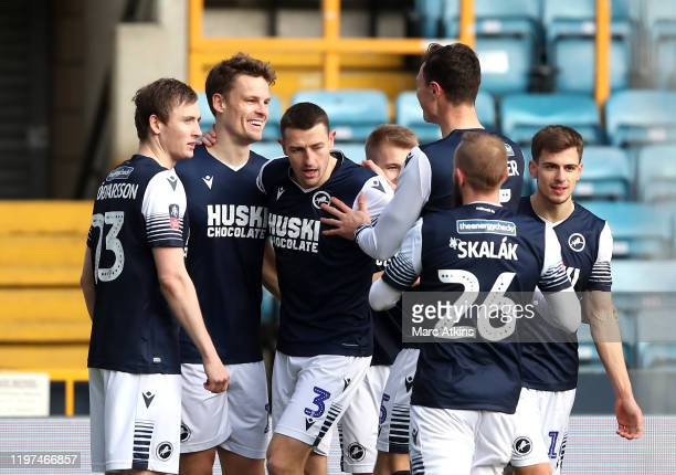 Mathieu Smith of Millwall celebrates with teammates after scoring his team's first goal during the FA Cup Third Round match between Millwall FC and...